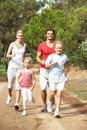 Family running on path in park Royalty Free Stock Photo