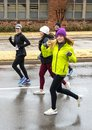 Family running the Turkey Trot in Edmond, Oklahoma on a cold rainy day. Royalty Free Stock Photo