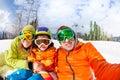 Family selfie on ski resort with little son