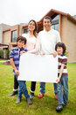 Family selling a house Royalty Free Stock Photography