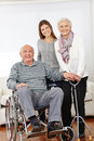 Family with senior citizen couple happy and granddaughter at home Stock Photography