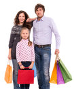 Family with shopping bags on a white background Royalty Free Stock Photos