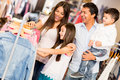 Family shopping clothes looking happy Royalty Free Stock Photography