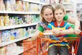 Family shopping at supermarket woman and child boy during with trolley Royalty Free Stock Image