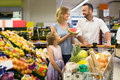 Family shopping various fresh fruits in supermarket Royalty Free Stock Photo