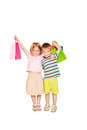 Family shopping young couple boy and girl a a hugging holding bags Stock Photography
