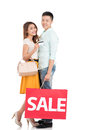 Family shopping a young happy couple with a bag and a credit card isolated on white Stock Photos