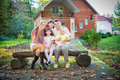 Family sitting in backyard of new home Royalty Free Stock Photography
