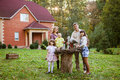Family sitting in backyard of new home Royalty Free Stock Images