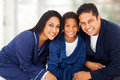 Family sitting bed cute young indian in their nightclothes on Royalty Free Stock Photos