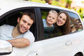 Family sitting in the car looking out windows happy Royalty Free Stock Photos