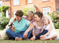 Family Sitting In Garden Together Royalty Free Stock Photo