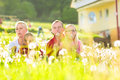Family sitting in meadow in front of home happy with daughters a summer Stock Photography