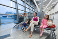 A family sitting in a recreation area of three at the airport Royalty Free Stock Photos