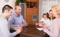 Family sitting at table with cards Royalty Free Stock Photo
