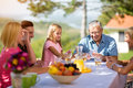 Family sitting at table playing cards Royalty Free Stock Photo