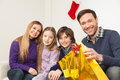 Family sitting together in christmas happy celebrating Stock Photo