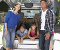 Family Sitting In Trunk Of Car Royalty Free Stock Photo