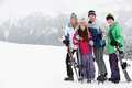 Family On Ski Holiday In Mountains Stock Photo