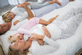 Family sleeping on bed in the bed room Royalty Free Stock Photo