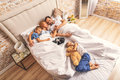 Family sleeping together on bed Royalty Free Stock Photo
