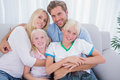 Family smiling at camera Royalty Free Stock Photo