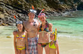 Family snorkeling happy and having fun on tropical beach vacation Royalty Free Stock Images