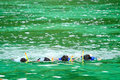 A family snorkeling in the ocean Royalty Free Stock Photo