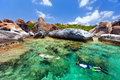Family snorkeling at tropical water of young mother and son in turquoise among huge granite boulders the baths beach area major Stock Photo