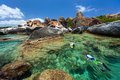 Family snorkeling at tropical water of young mother and son in turquoise among huge granite boulders the baths beach area major Stock Photos