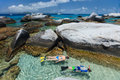 Family snorkeling at tropical water of young mother and son in turquoise among huge granite boulders the baths beach area major Royalty Free Stock Photos