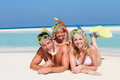 Family snorkels enjoying beach holiday smiling Stock Photos