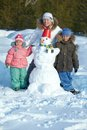 Family with snowman Stock Images