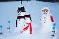 Family of snowmen in the countryside Stock Images