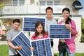 Family with solar panels Royalty Free Stock Photo