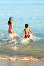 Family splash in warm water. Royalty Free Stock Photo