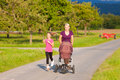 Family sport - jogging with baby stroller Royalty Free Stock Photo