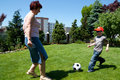 Family sport - playing soccer (football) Stock Images