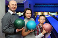 Family stand and hold balls for bowling Royalty Free Stock Image