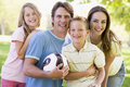 Family standing holding volleyball smiling Royalty Free Stock Images
