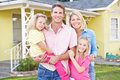 Family Standing Outside Suburban Home Royalty Free Stock Photo