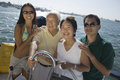 Family at steering wheel of sailboat portrait happy Royalty Free Stock Photos