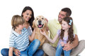 Family stroking dog happy over white background Royalty Free Stock Photography
