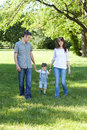 Family stroll image of young taking a in the nature Royalty Free Stock Photo