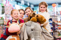 Family with stuffed elephant in toy store playing Royalty Free Stock Photo