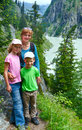 Family in summer alps mountain switzerland landscape and on slope Royalty Free Stock Photography