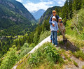 Family in summer alps mountain switzerland landscape and on slope Royalty Free Stock Image