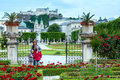 Family summer gardens mirabell palace red rose flowerbeds hohensalzburg fortress behind salzburg austria all people behind not Stock Photography