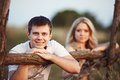Family at sunset young couple near a wooden fence Royalty Free Stock Photo