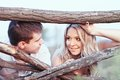 Family at sunset young couple near a wooden fence Royalty Free Stock Images